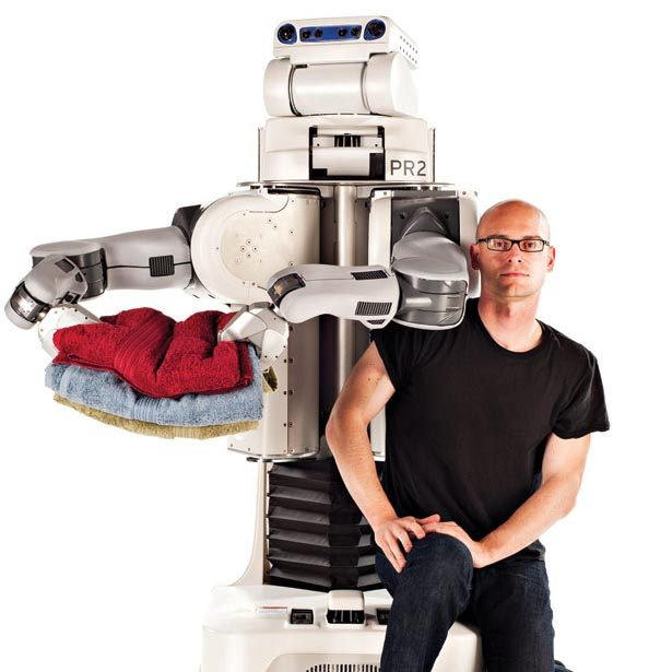 Helping hands: Pieter Abbeel has programmed robots to learn how to perform tasks without detailed instructions. This robot can fold laundry, while others can fly model helicopters or tie sutures.
