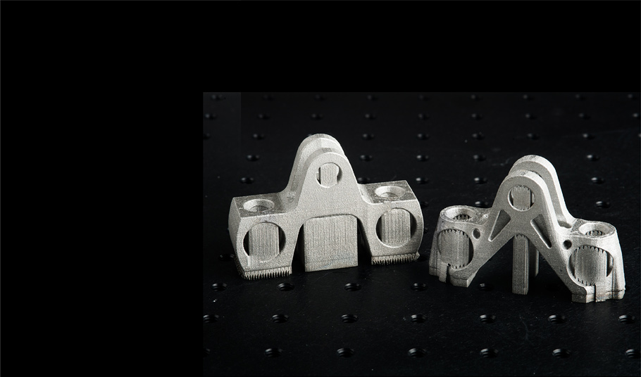 Prototypes of brackets for airplane engines show how additive manufacturing can produce complex, precisely designed shapes like the one at right.