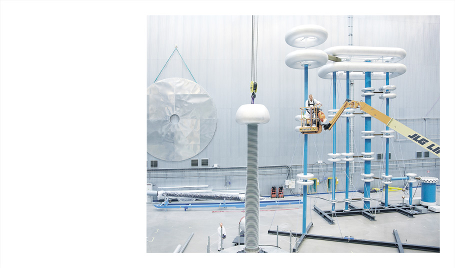 At ABB's lab in Sweden, equipment such as corona shields—polished disks linked to form spheres—are used to test a high-voltage DC circuit breaker.