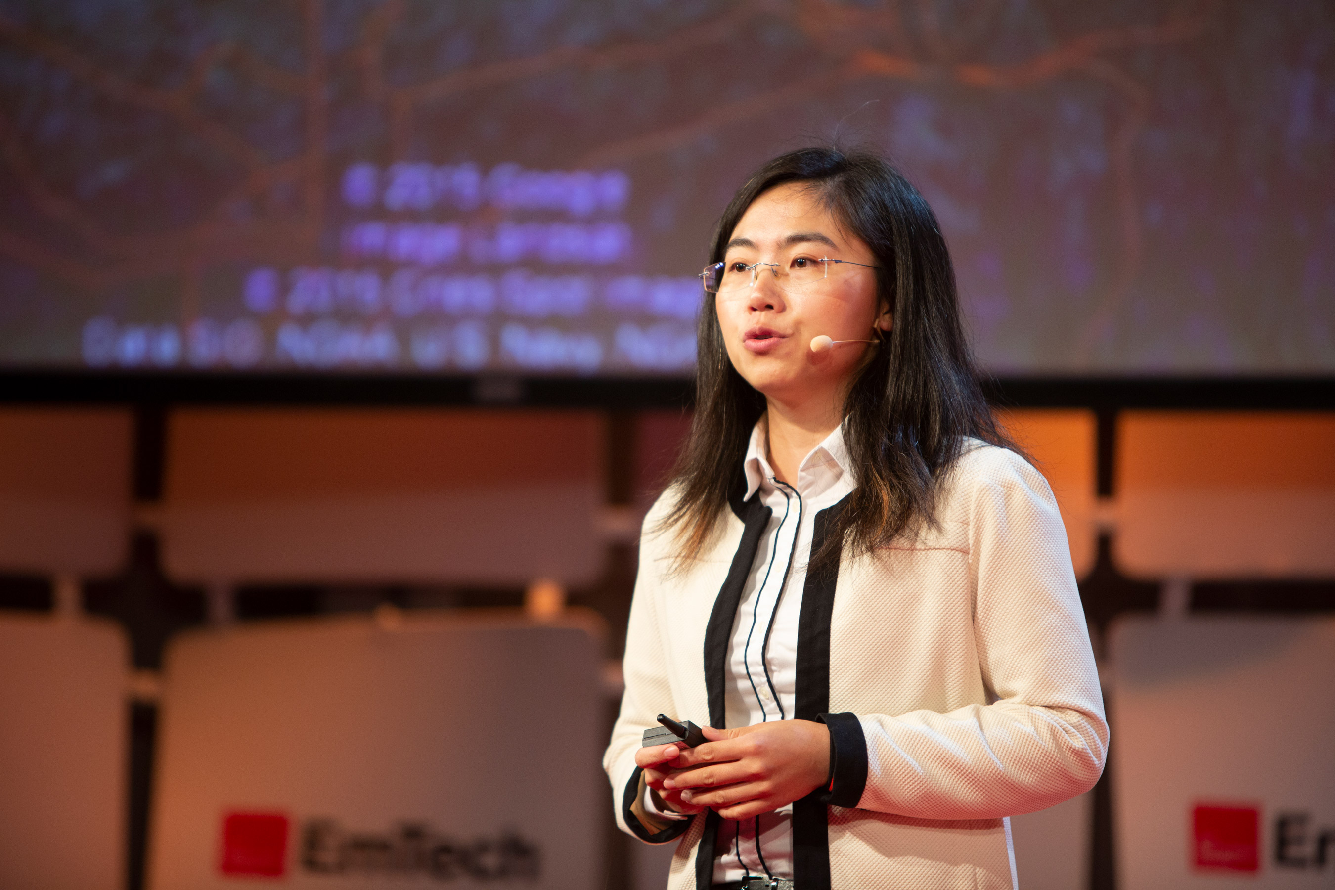 Photo of Fei Fang speaking at EmTech 2018