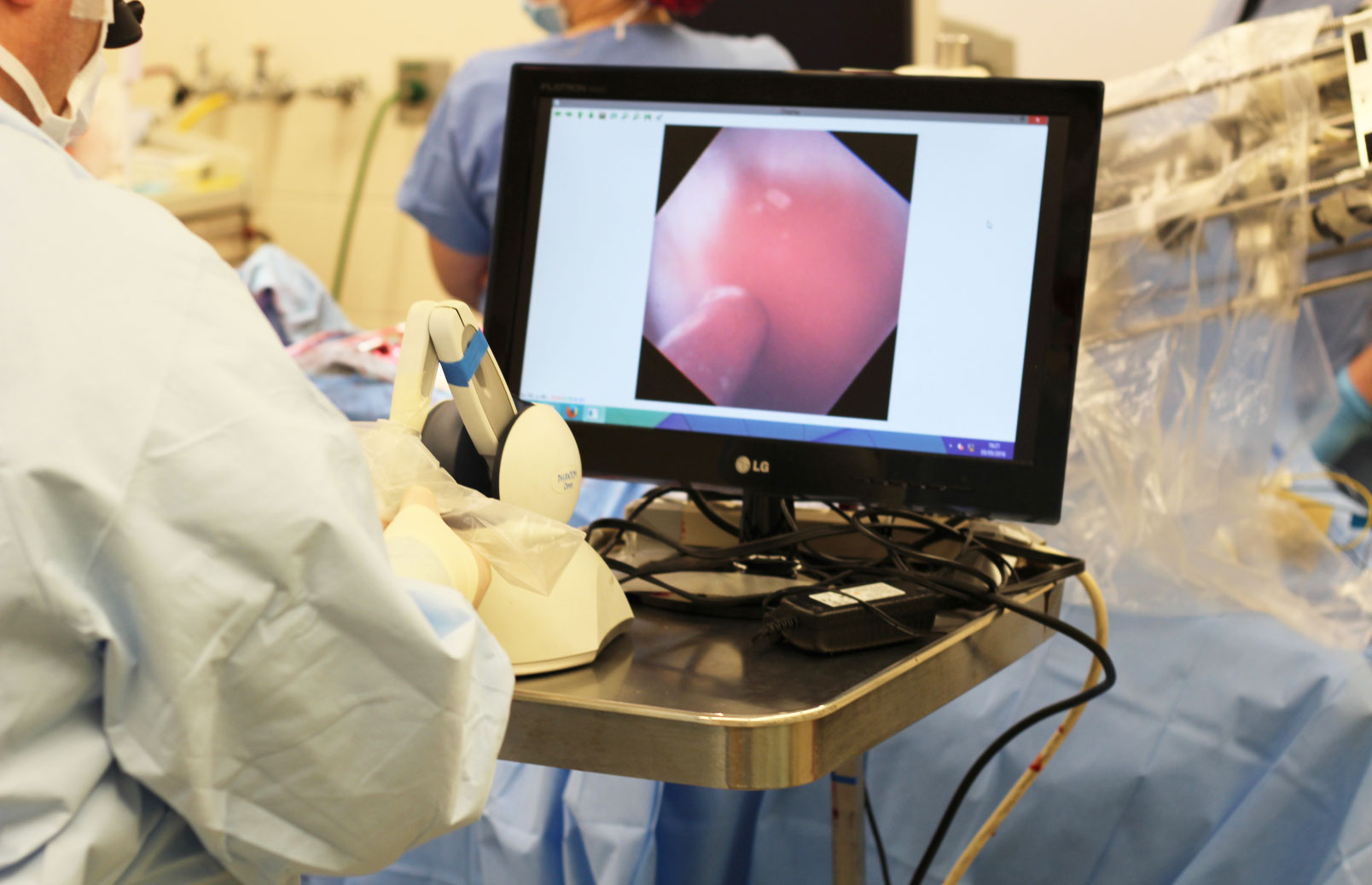 Image of medical professional looking at laparoscopy viewing screen