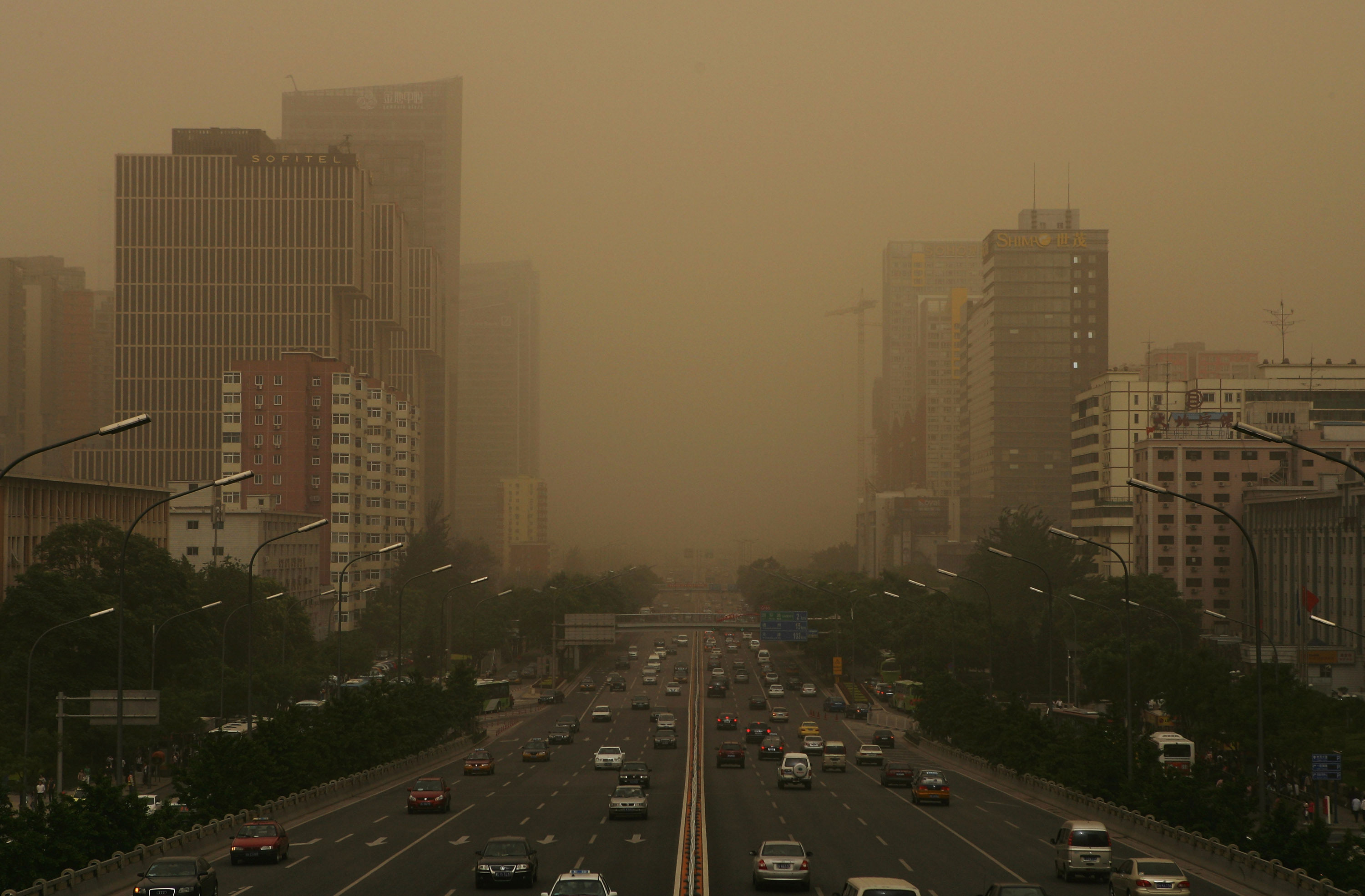 An image of a busy Bejing road covered  in smog