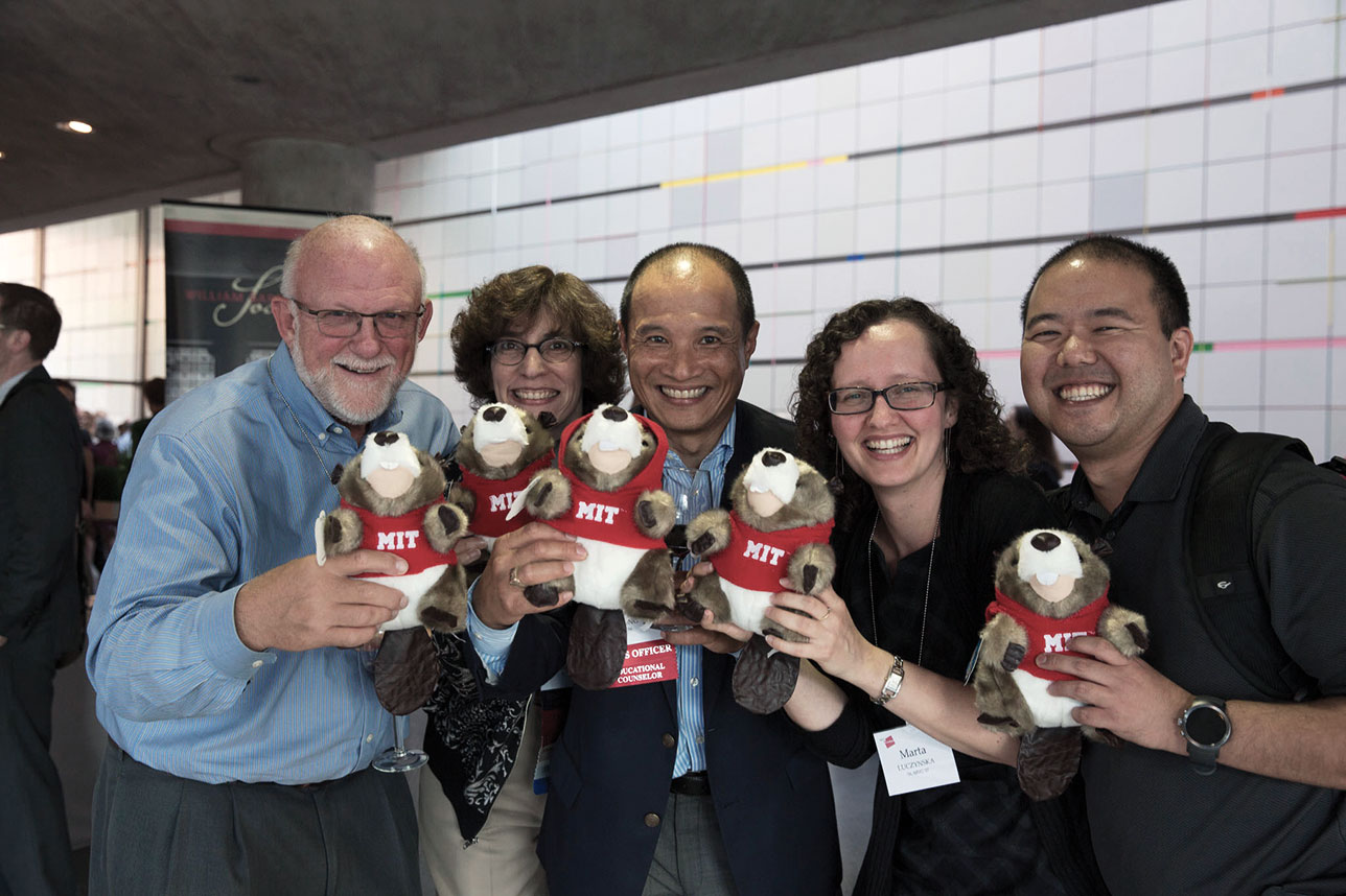 Photo of volunteers holding beaver stuffed animals