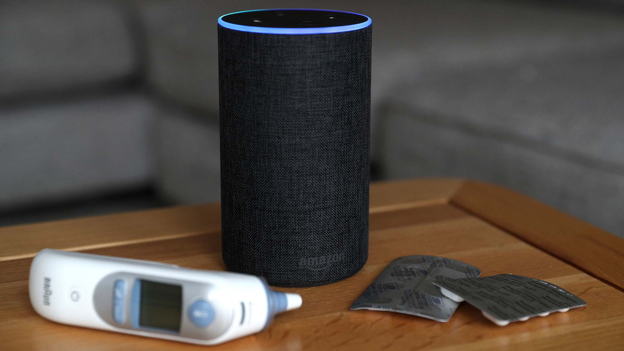 An Amazon Echo with tablets and a temperature probe beside it