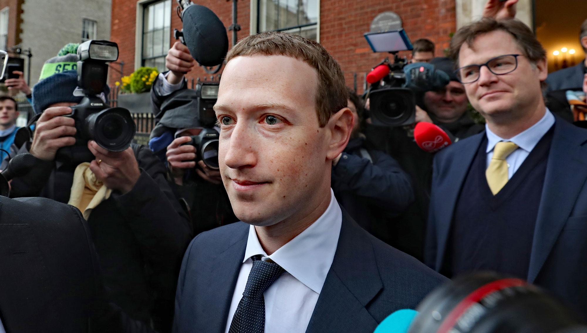 Mark Zuckerberg leaves a shareholder meeting