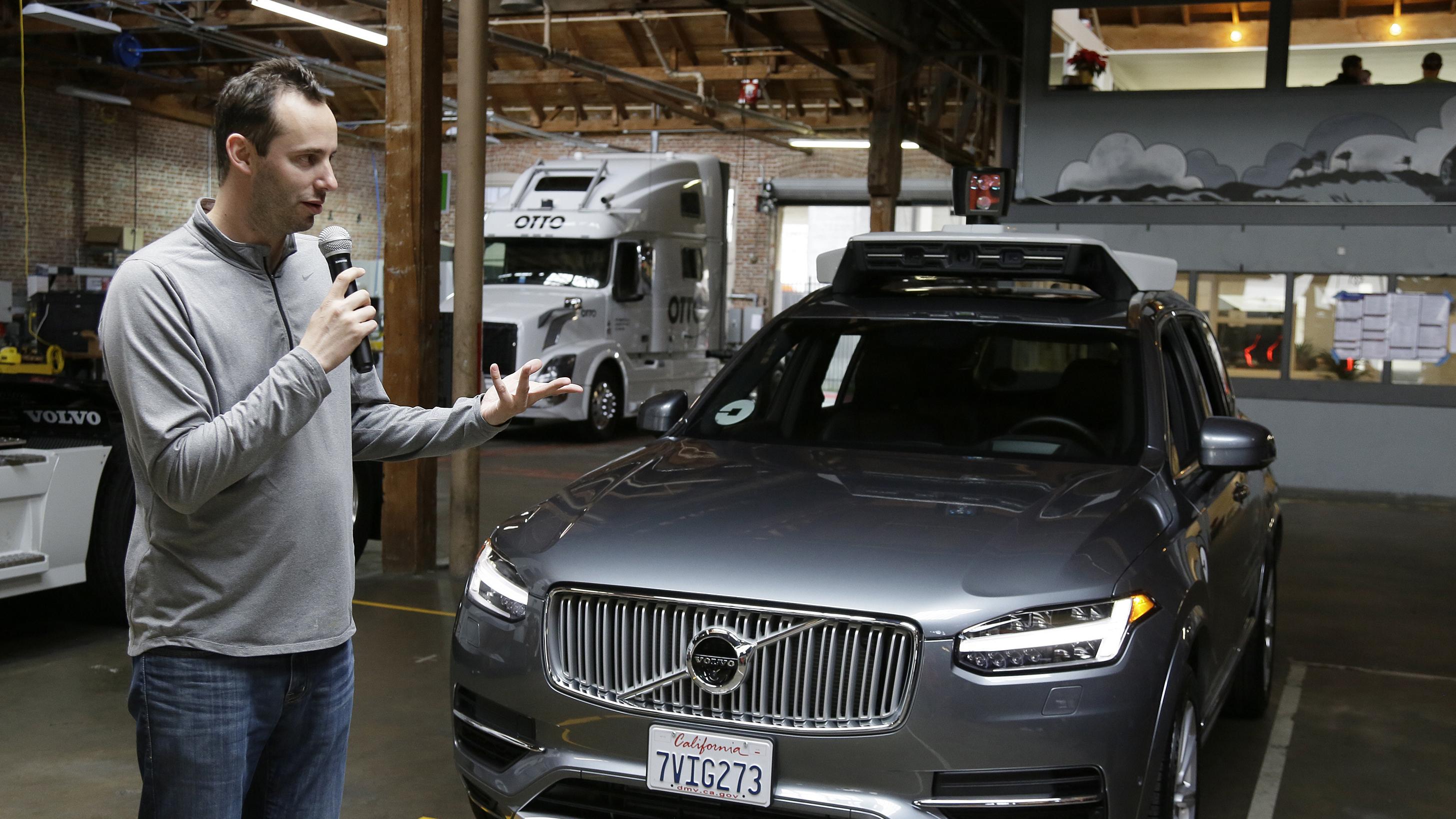 Anthony Levandowski with Uber self-driving car