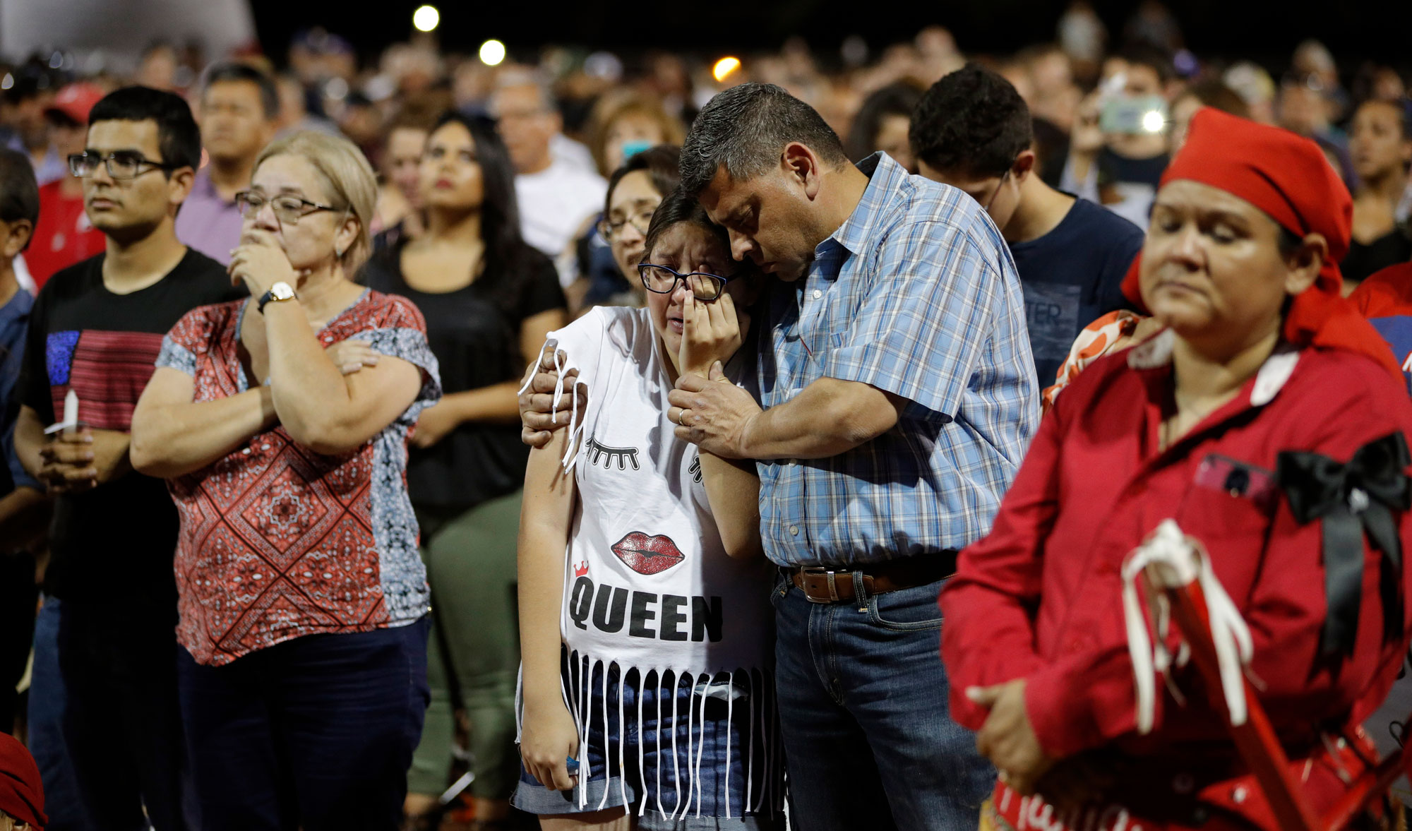 People grieving in El Paso after a mass shooting last weekend