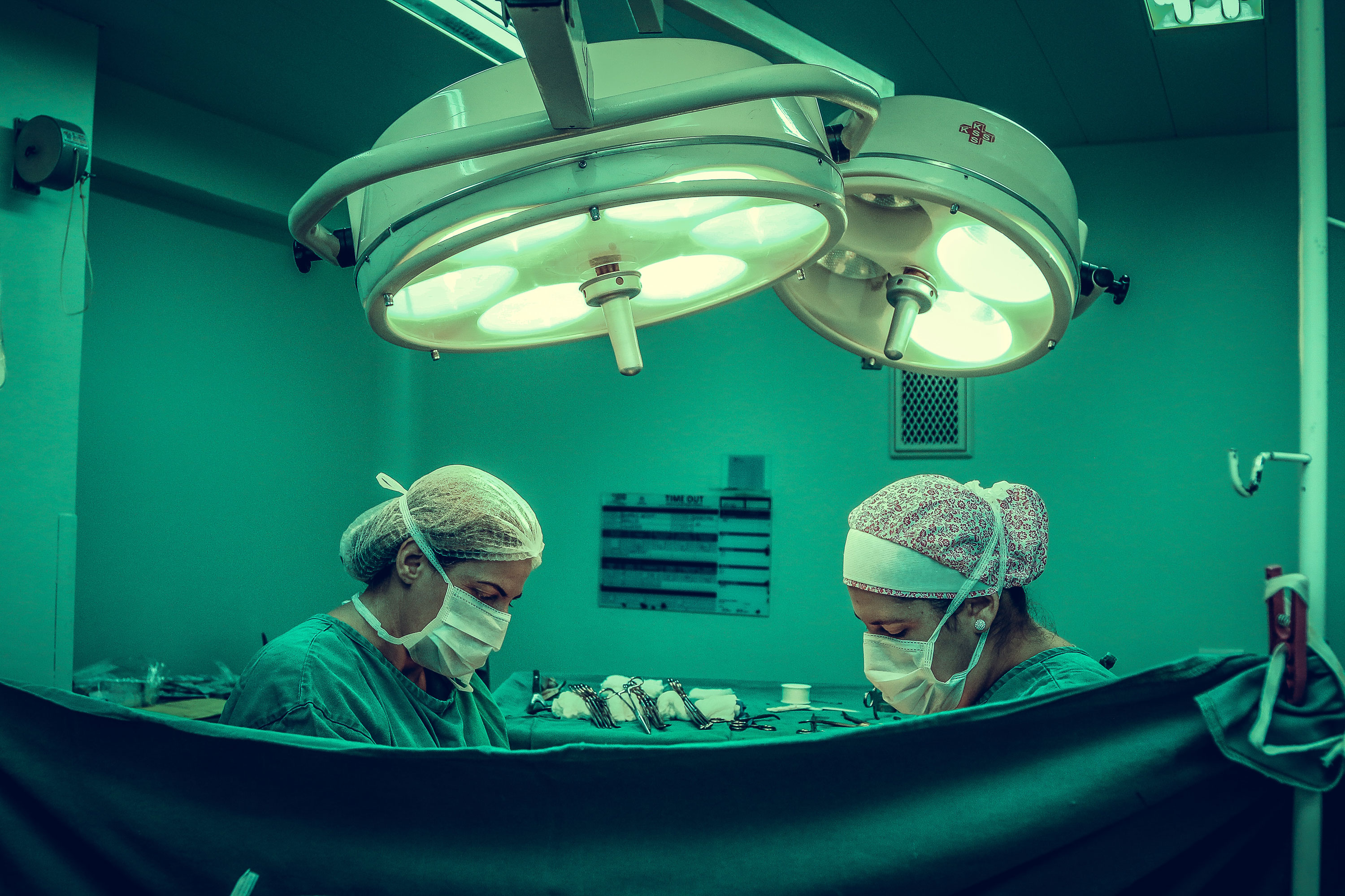 healthcare workers in operating room