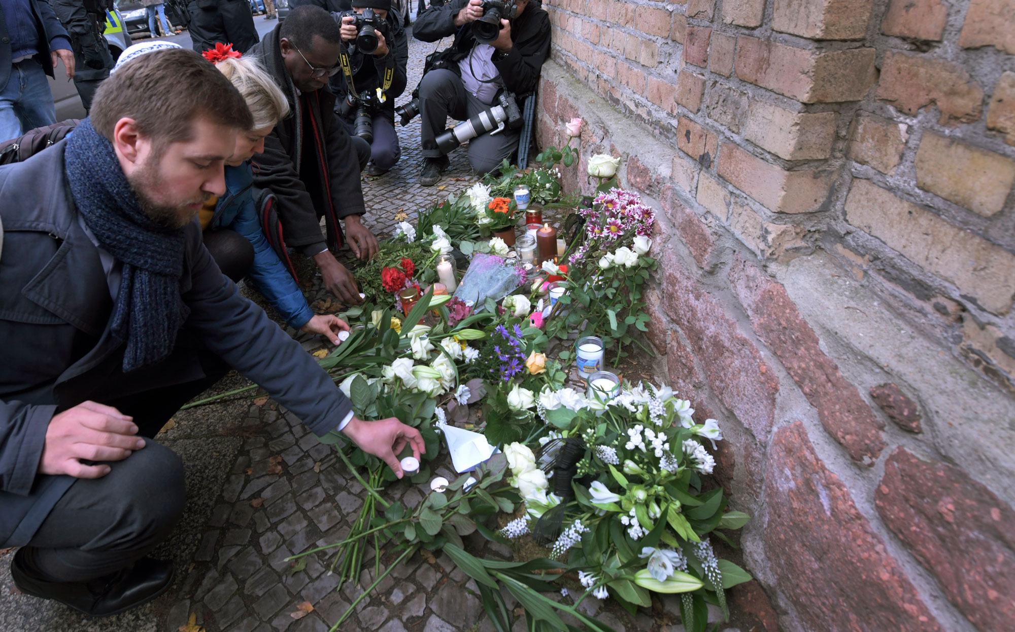 Mourners lay flowers at the site of the Halle synagogue attack