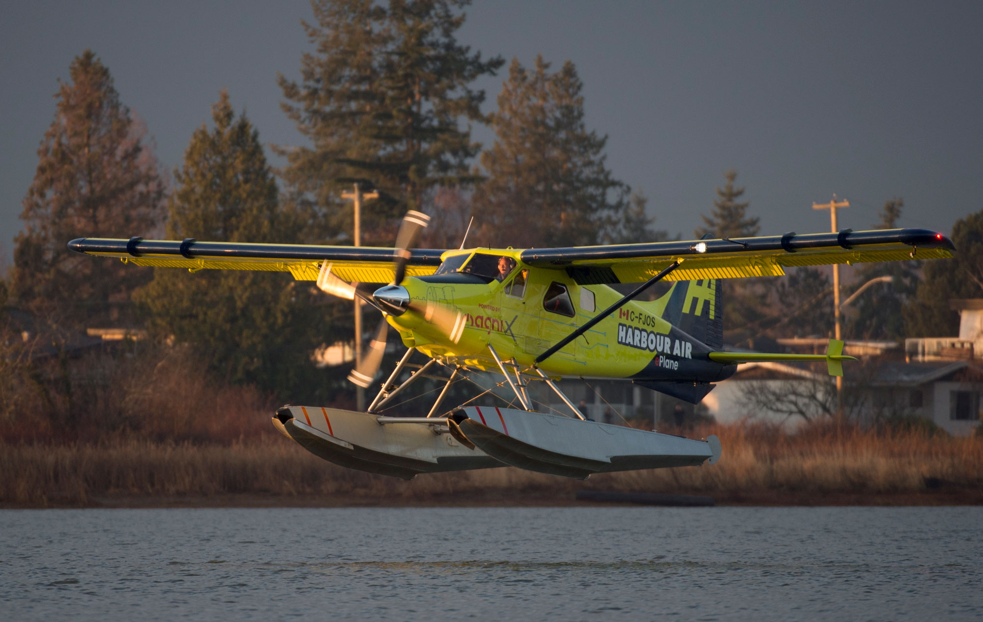 The world's first electric commercial aircraft owned and operated by Harbour Air is seen landing following its maiden flight in Richmond, B.C.