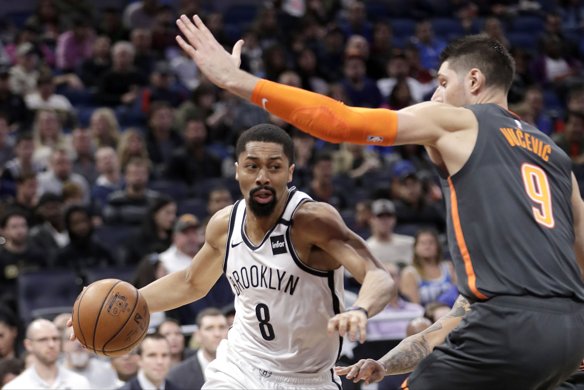 Brooklyn Nets guard Spencer Dinwiddie dribbling past a defender.