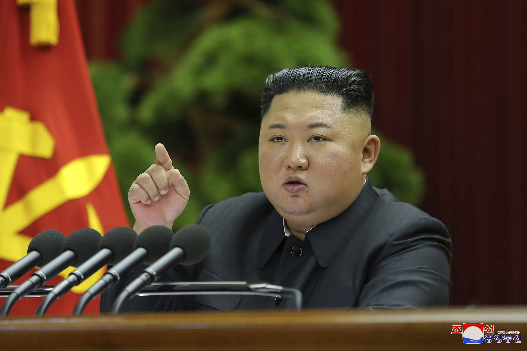 North Korean leader Kim Jong-un speaks into a microphone during a recent political conference in Pyongyang.