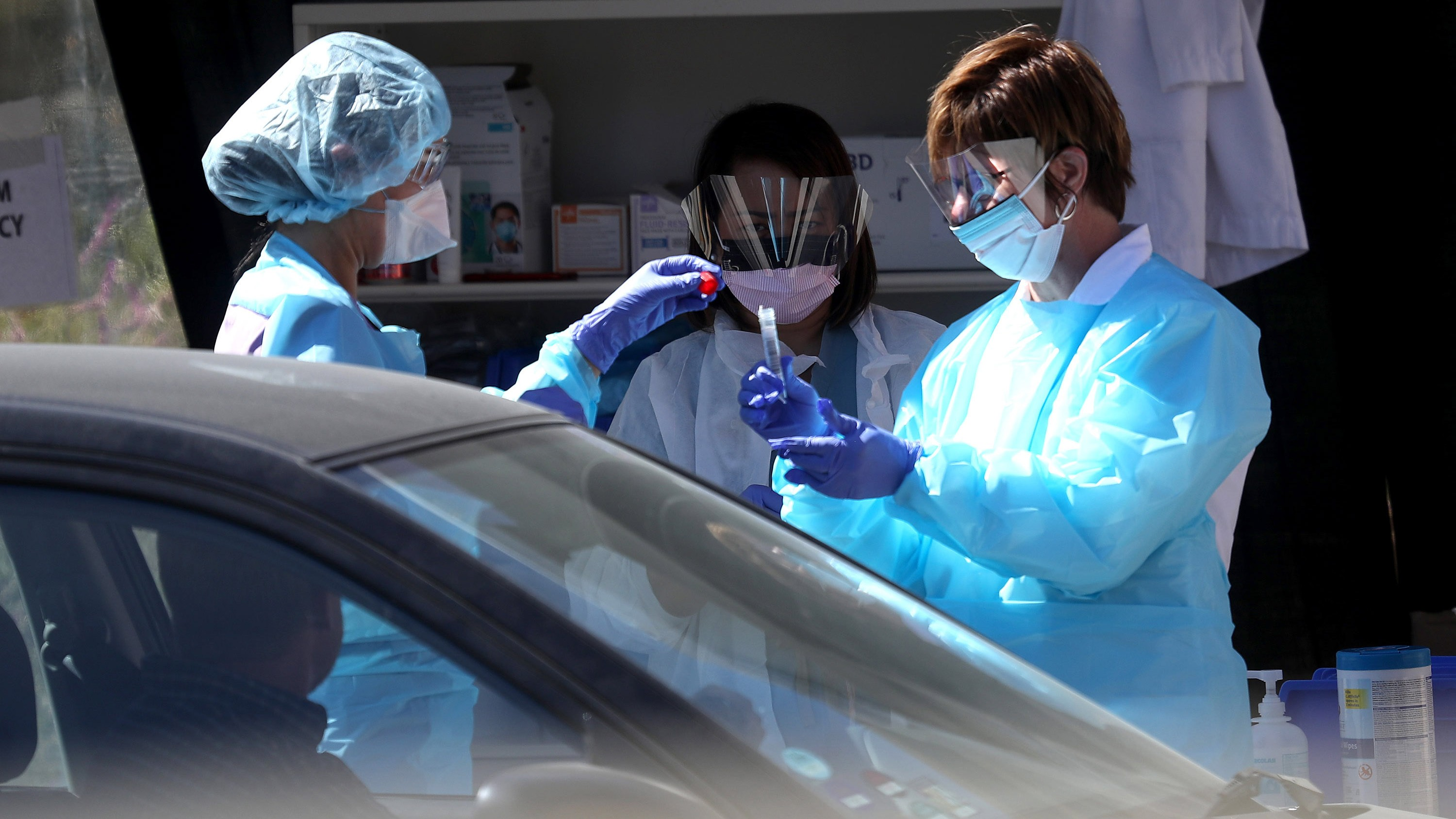 Medical personnel obtain samples at a drive-thru coronavirus testing station in San Francisco.