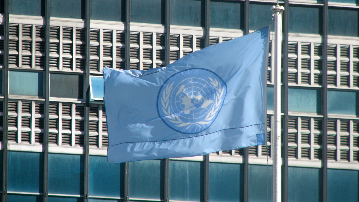 Flag of the United Nations flies over the UN Headquarters building in New York City, NY. USAID  photo