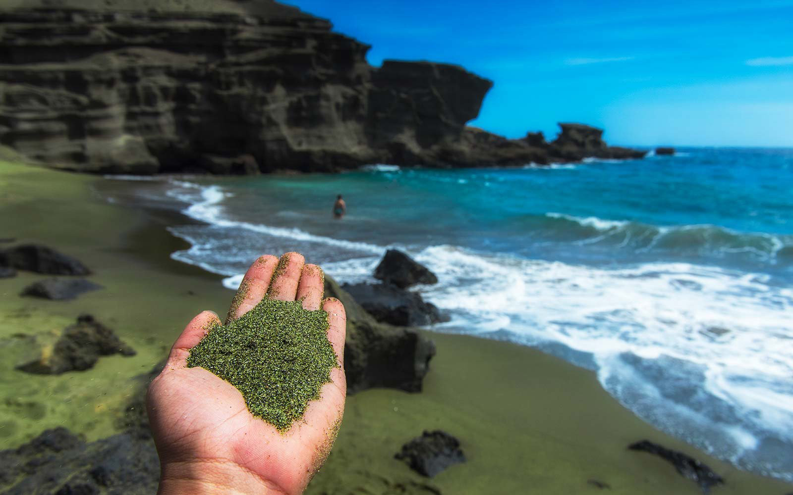 green sand beach with closeup of sand