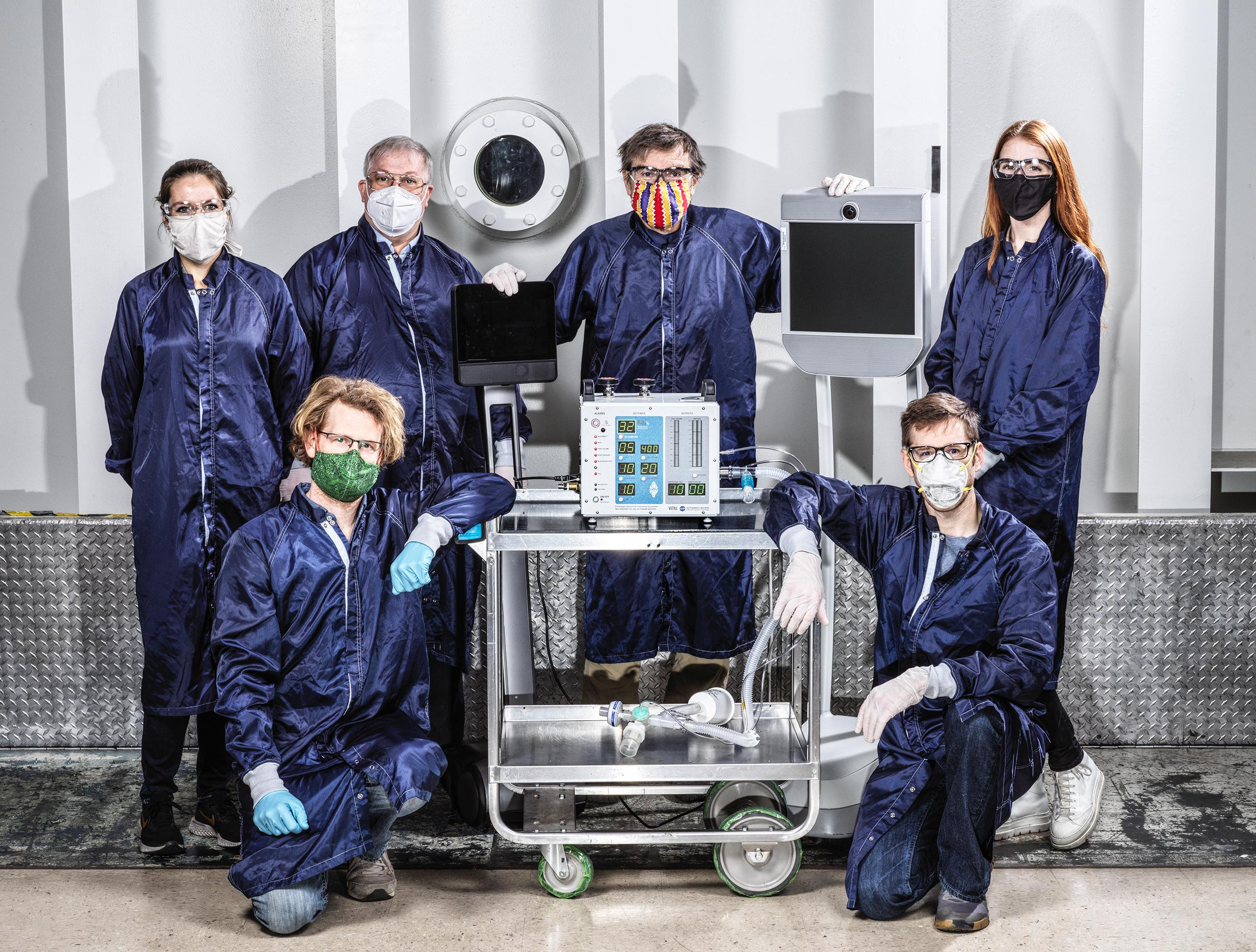 engineers with ventilator prototype