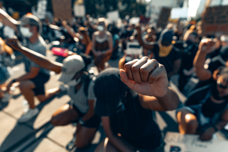 protestors in Charlotte, NC kneel for George Floyd