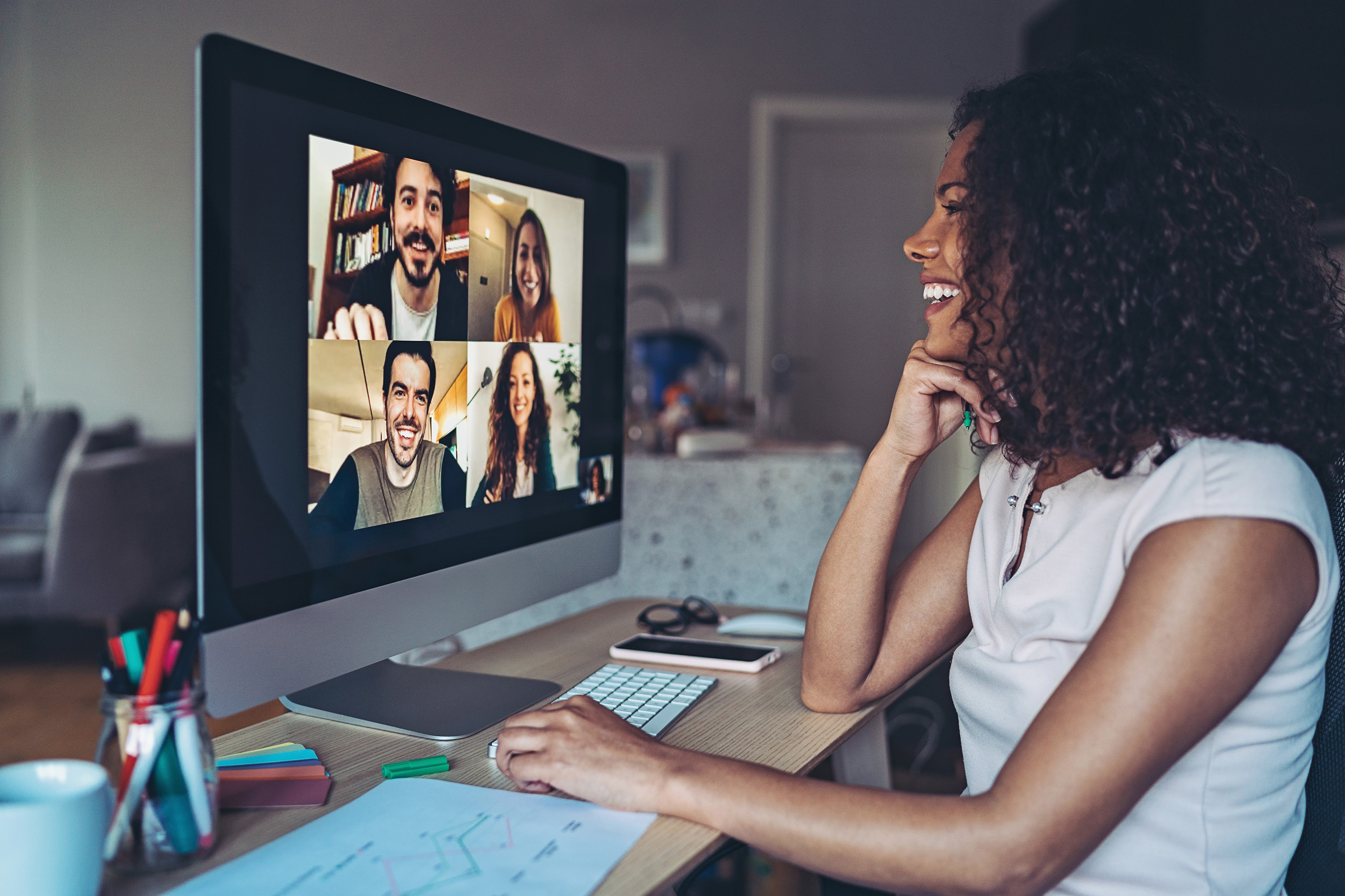image of woman on video conference with four other people