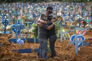 Bereaved at coronavirus graves in Manaus