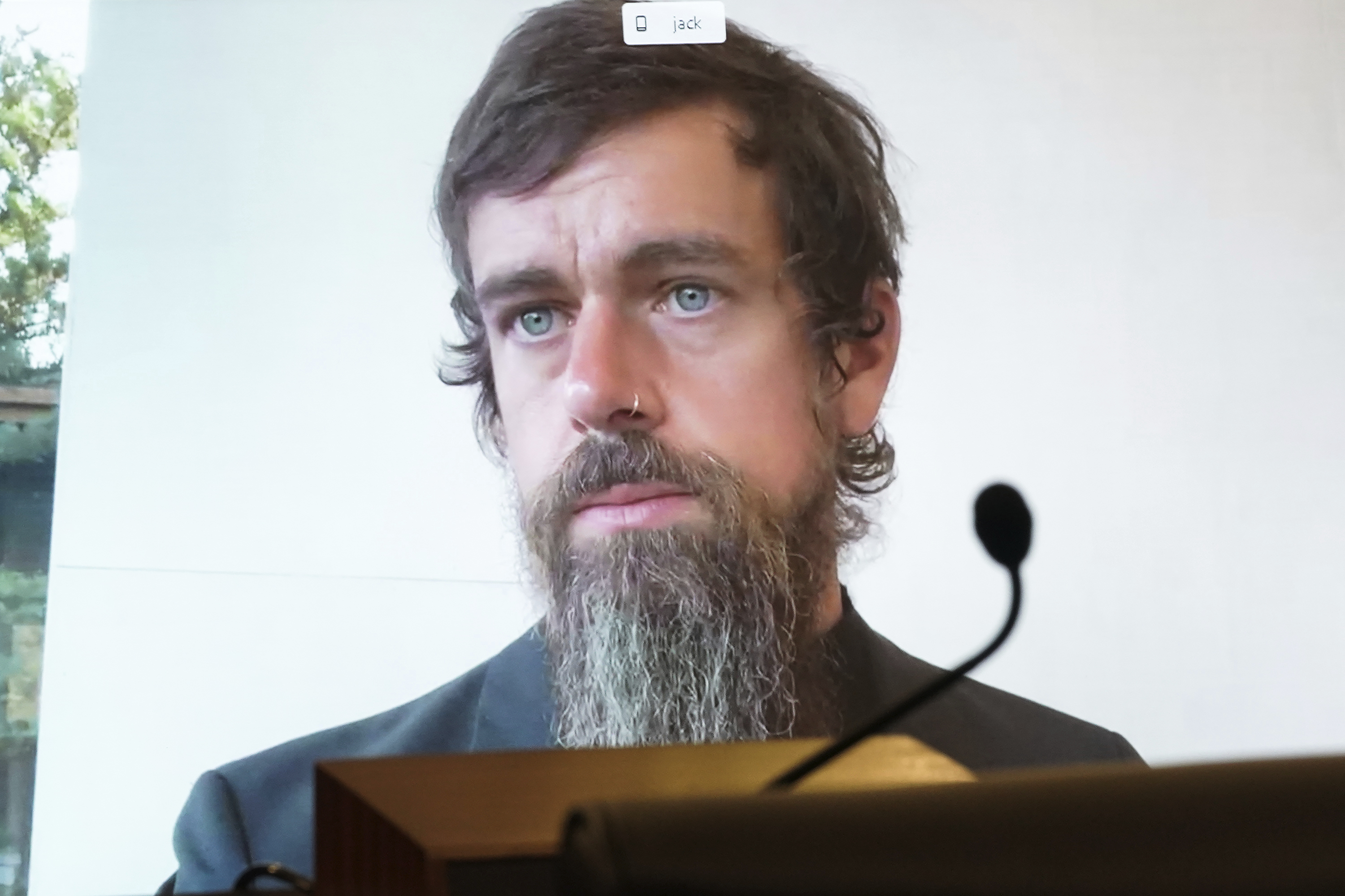 Twitter CEO Jack Dorsey appears on a screen as he speaks remotely during a hearing before the Senate Commerce Committee