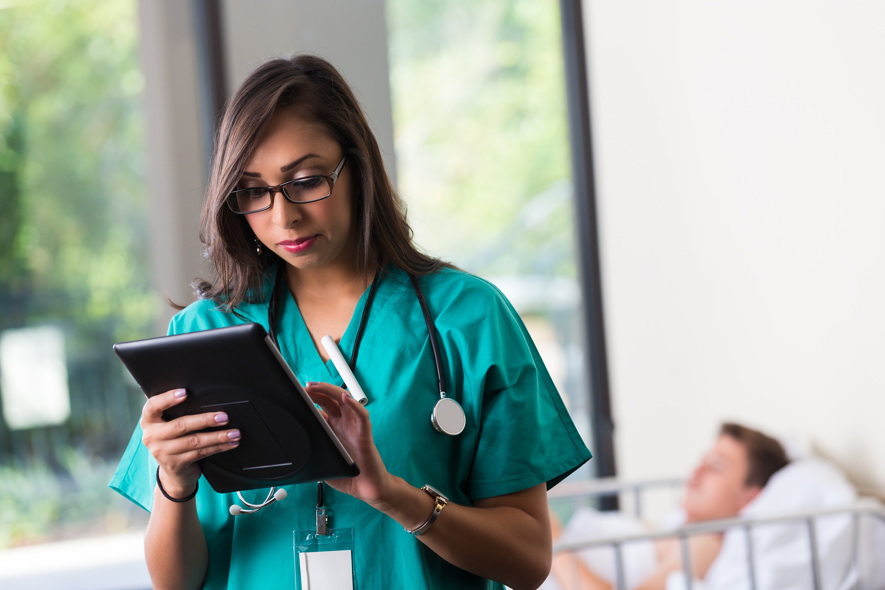 doctor checks patient assessment on ipad