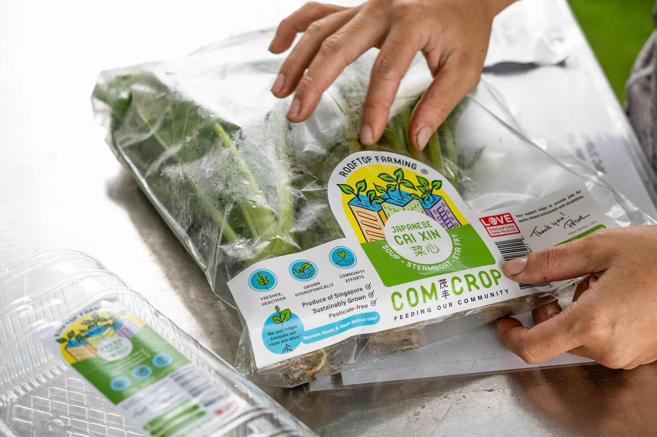 comcrop worker packaging greens