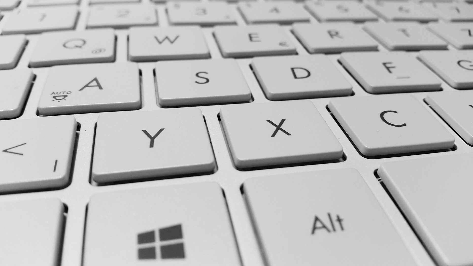 A zoomed-in shot shows keys on a white keyboard.