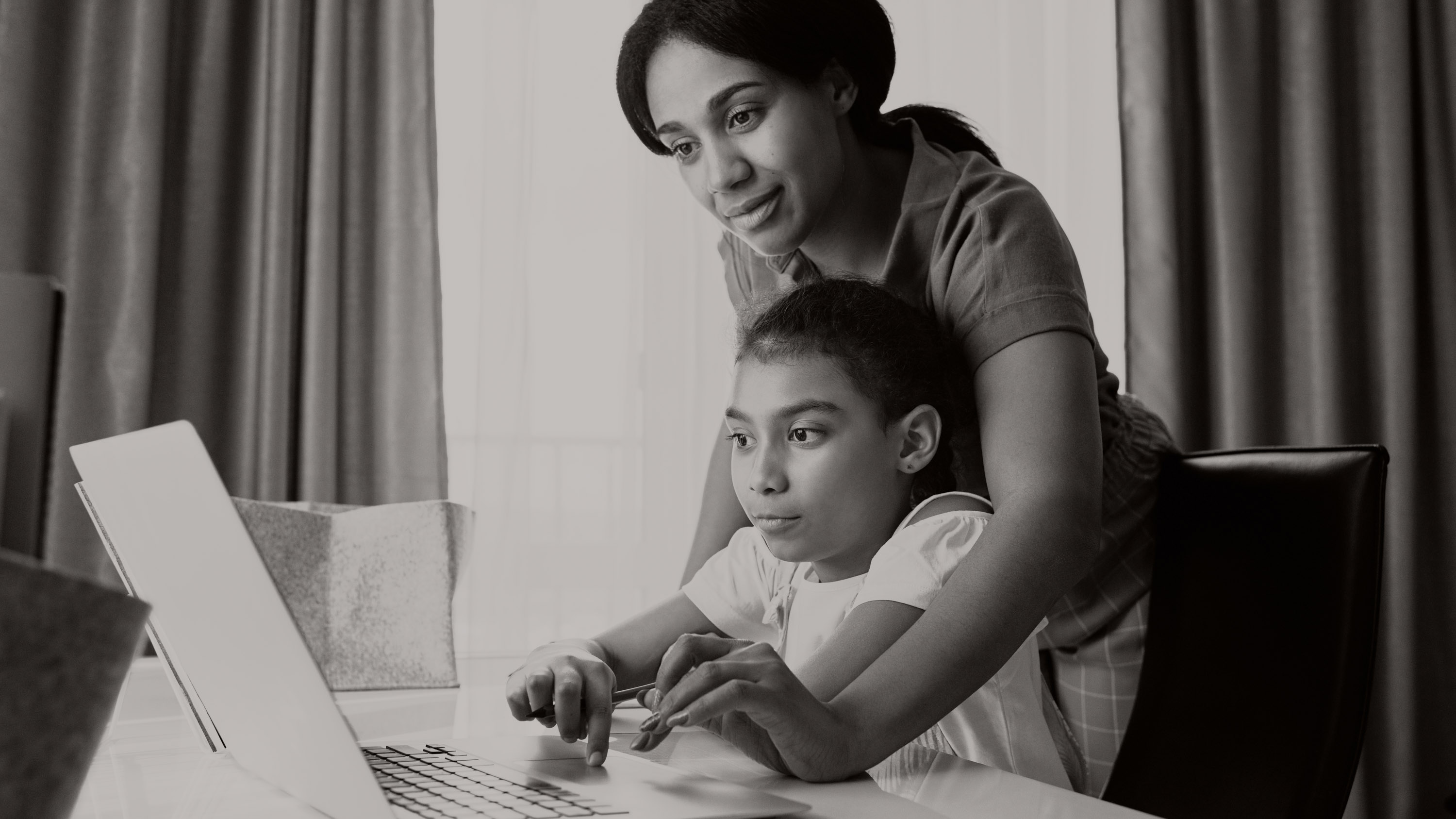 mom on laptop with son