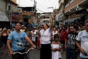 woman protests killing of Agatha Felix