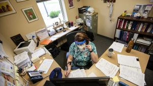 Public Health Nurse Joli Carr asks a series of questions to someone who has tested positive for the coronavirus in Gillette, Wyoming
