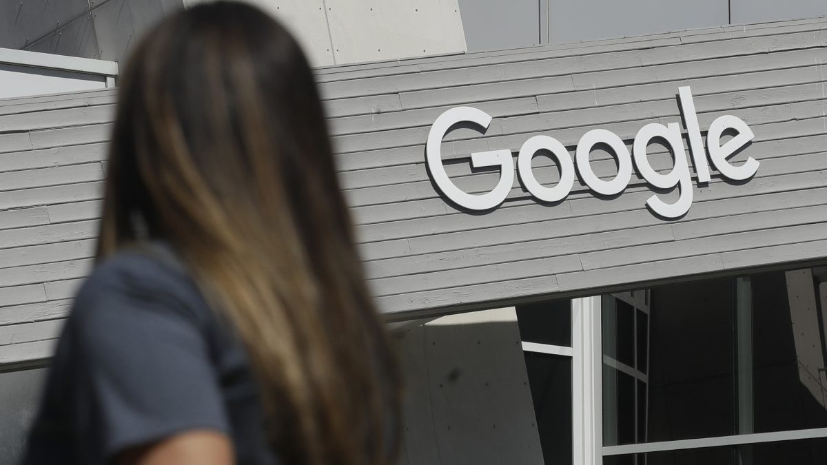 A woman outside Google's headquarters in Mountain View, California
