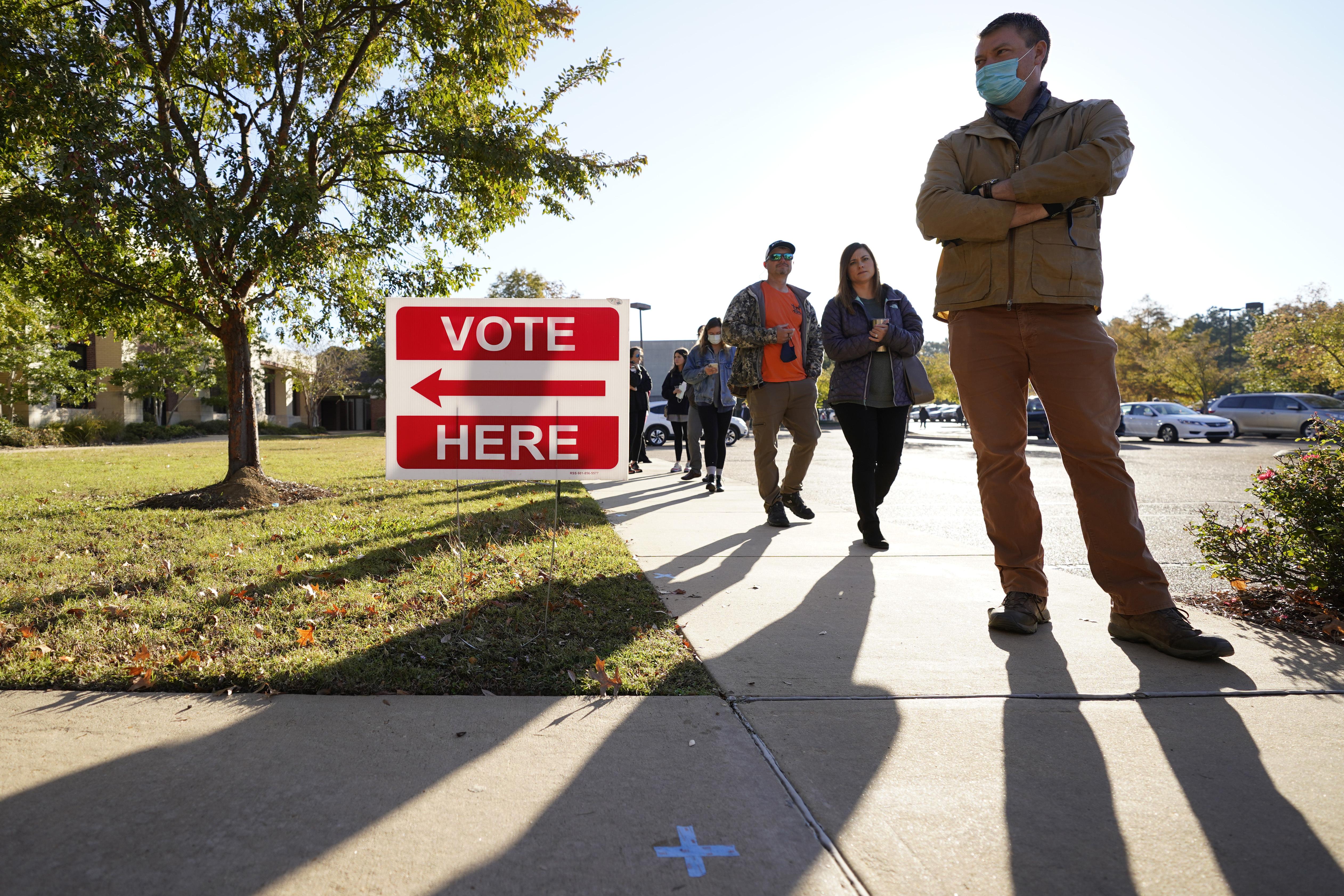 Voters wait to cast their ballot in Ridgeland, Miss.