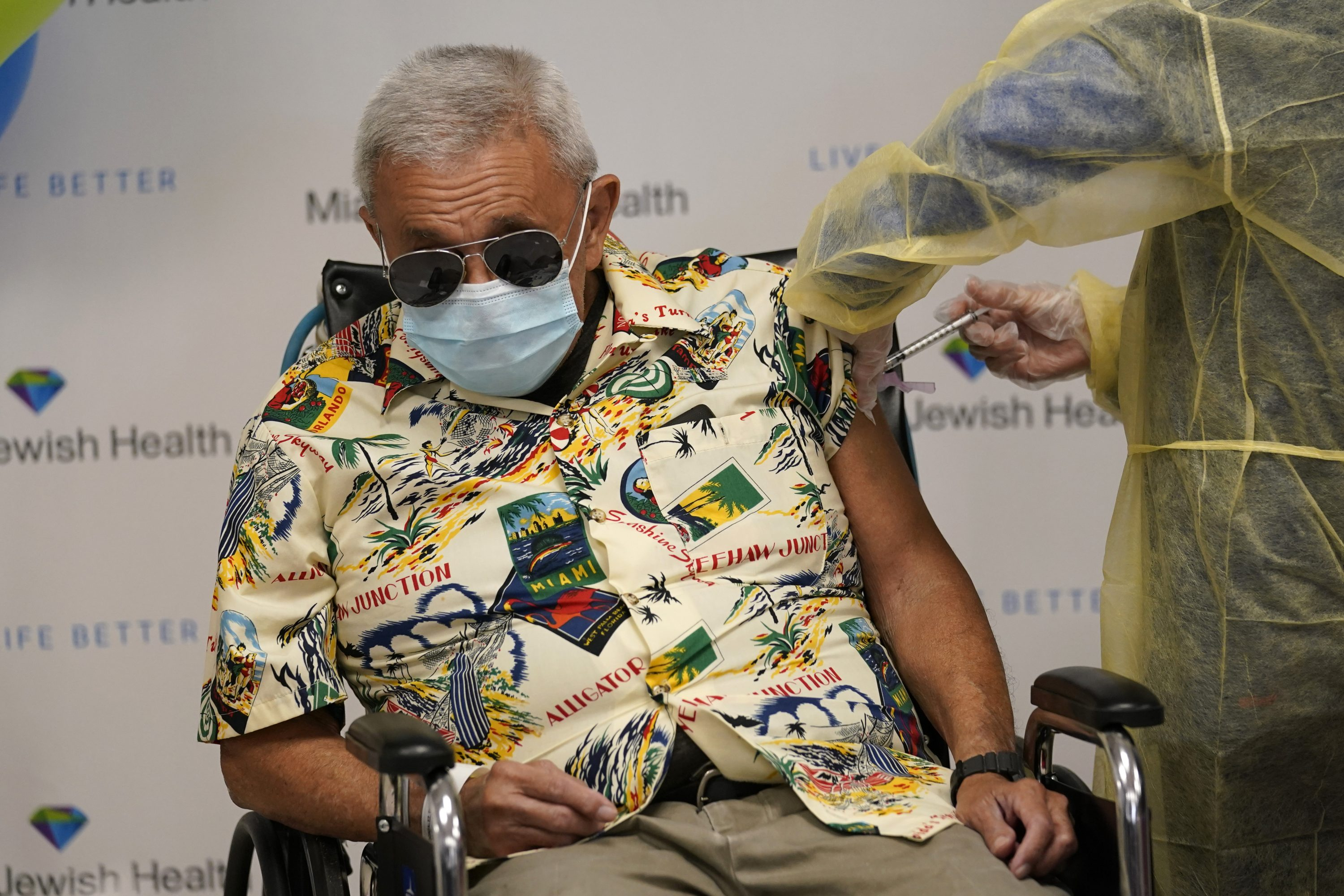 An elderly man is inoculated with the Moderna COVID-19 vaccine