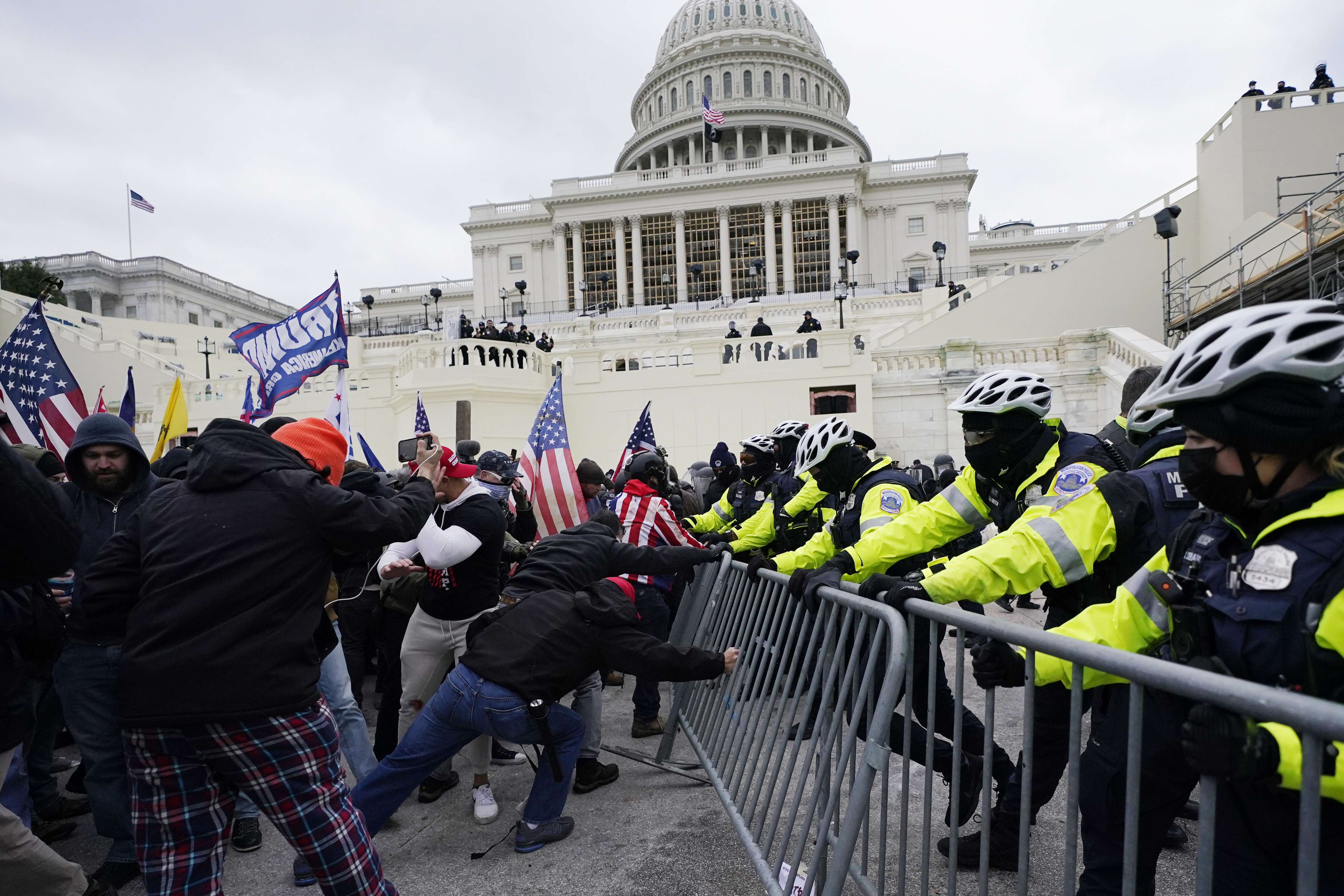 Trump supporters try to break through a police barrier on their way to occupy the Capitol in Washington.
