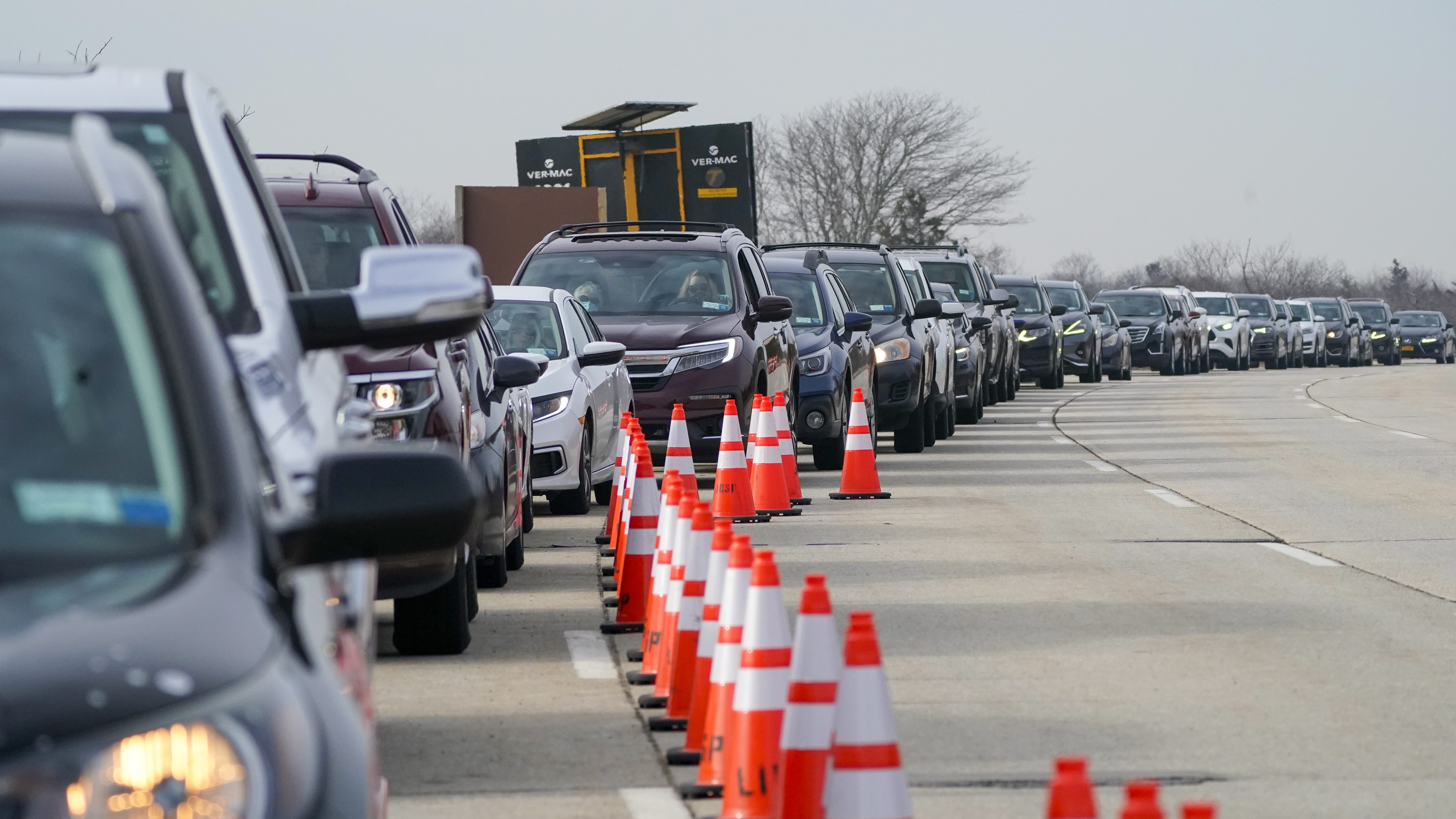 Cars line up in Wantagh, NY for the covid-19 drive-through vaccination site.