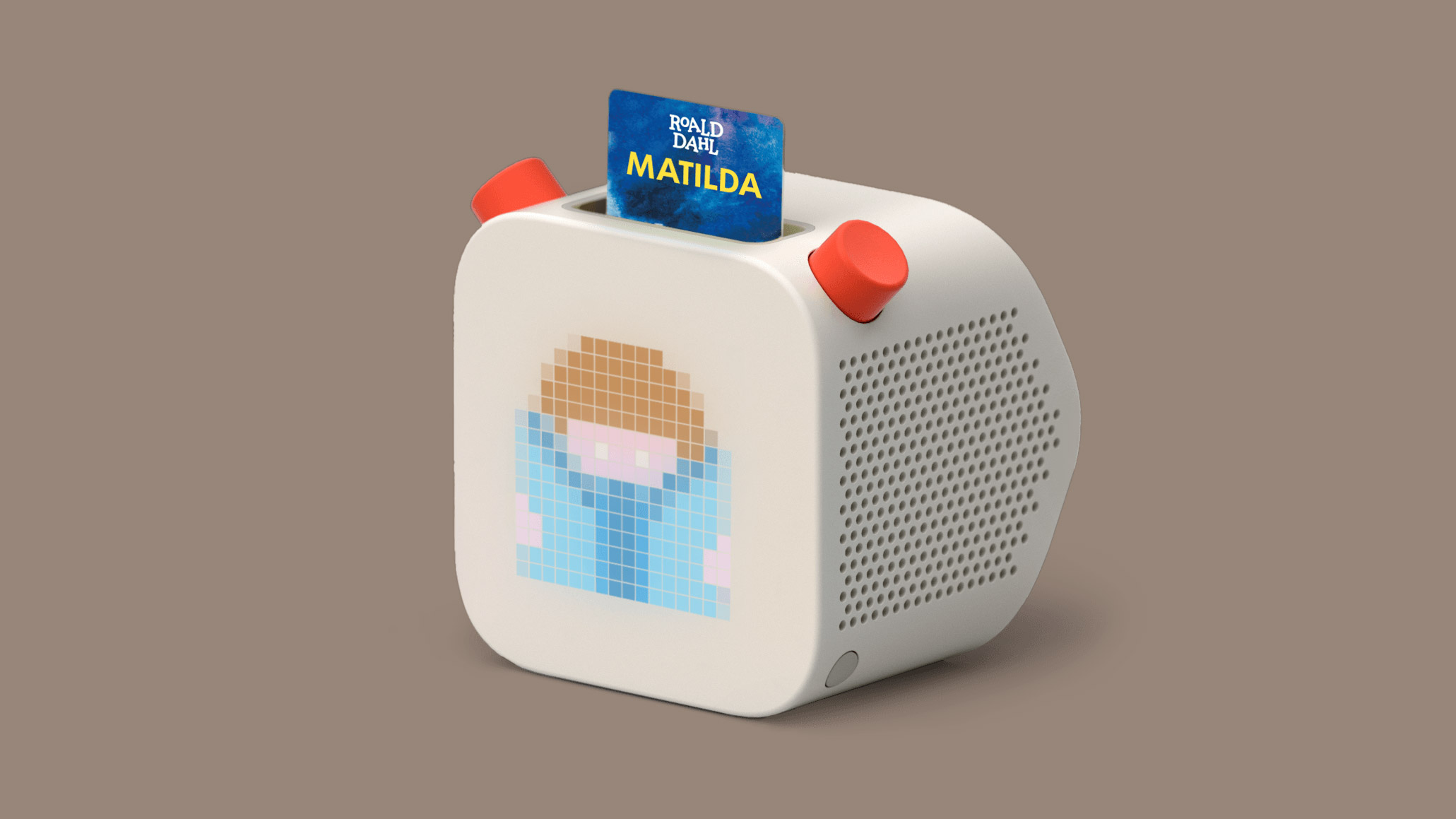 image of white radio looking box with a slot inserted that reads matilda yoto audio device for kids