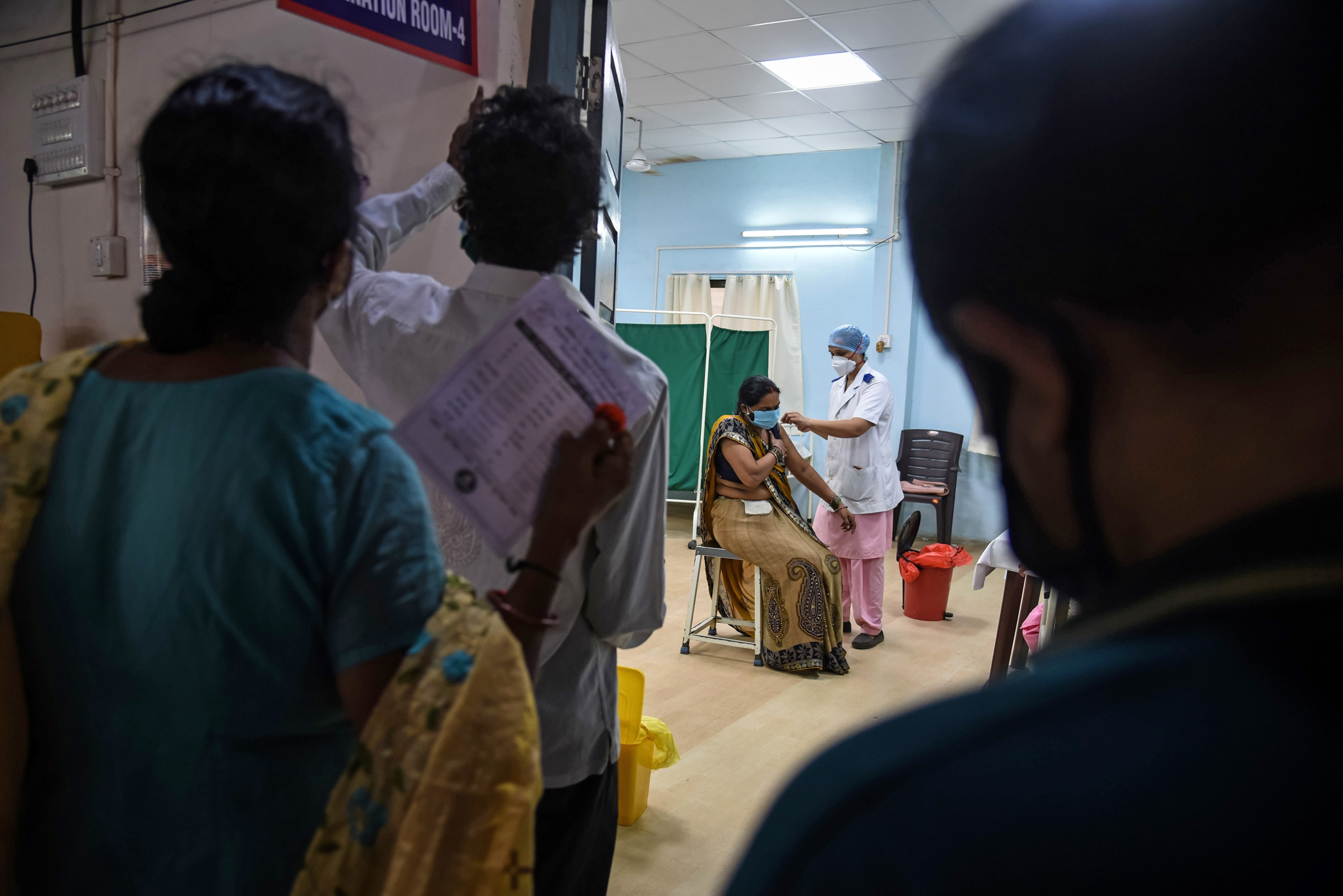 people waiting in line for vaccine Mumbai