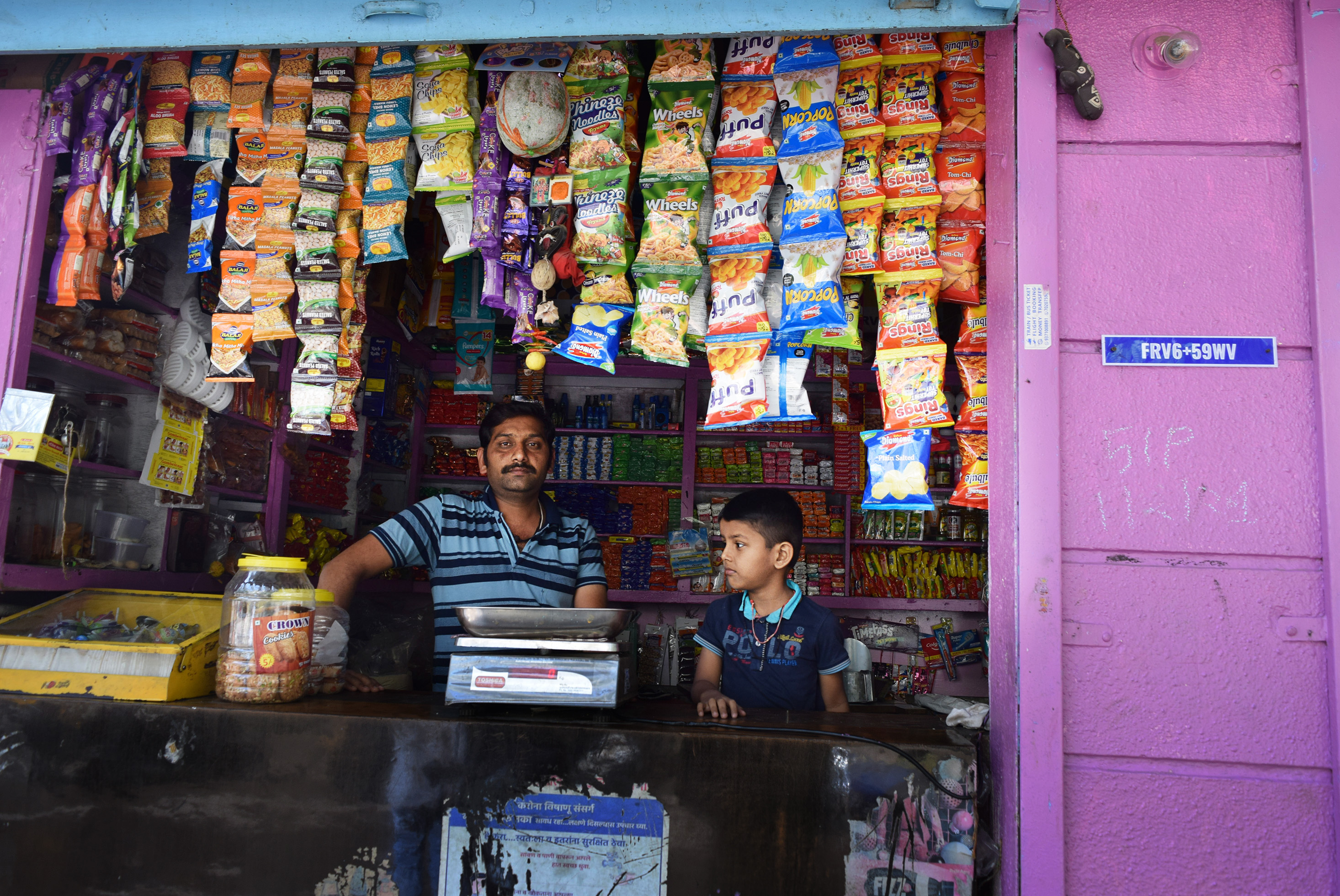 Grocer's shop with Google Plus address code displayed