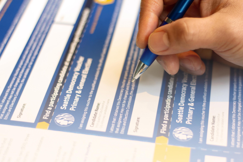 signing a democracy voucher