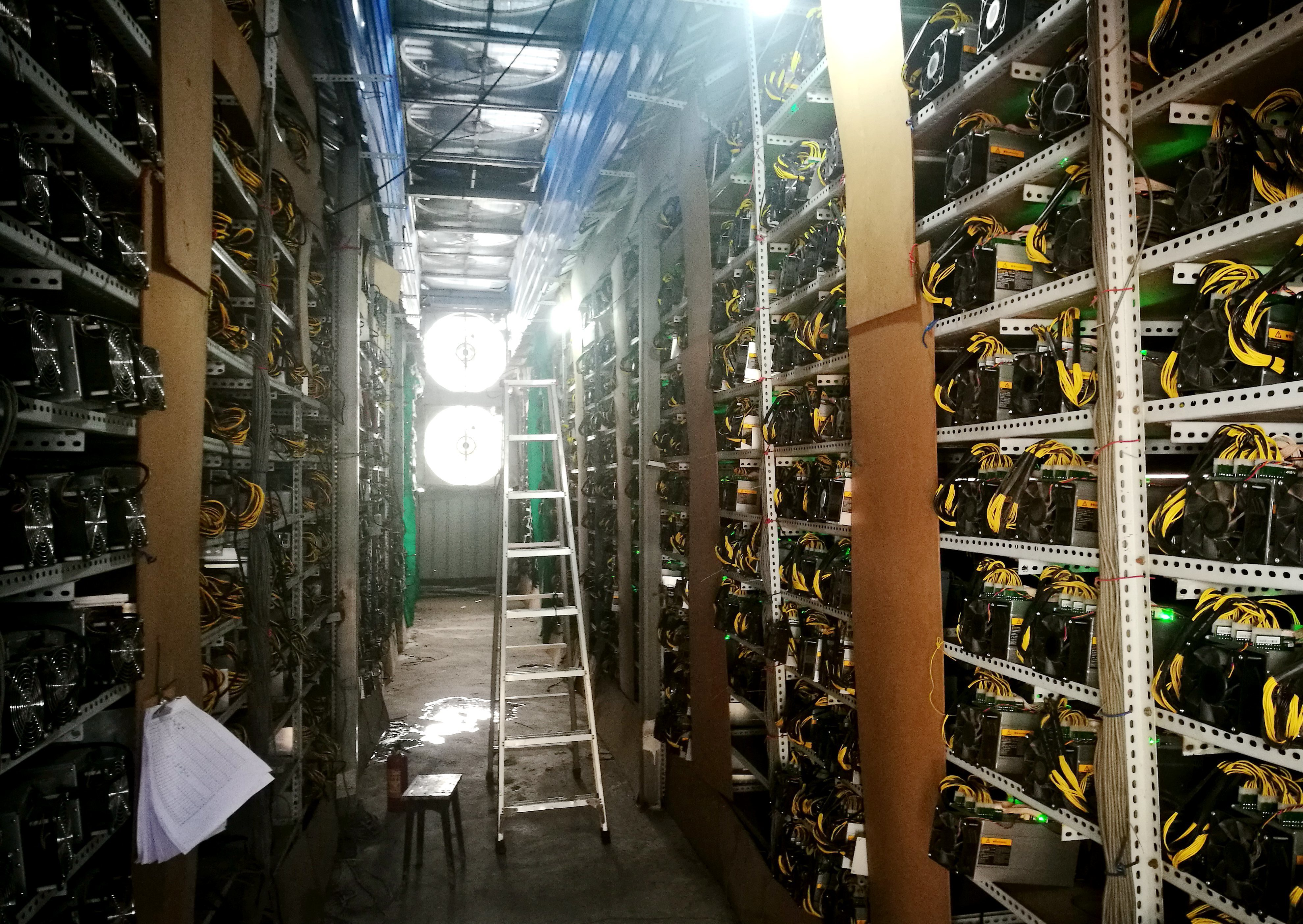 Bictoin mining machines are running at a bitcoin farm in China's Sichuan province