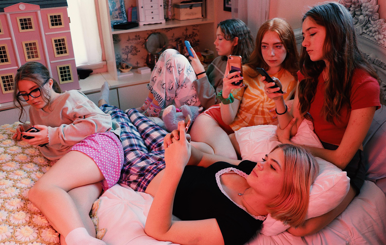 teenage girls on their phones