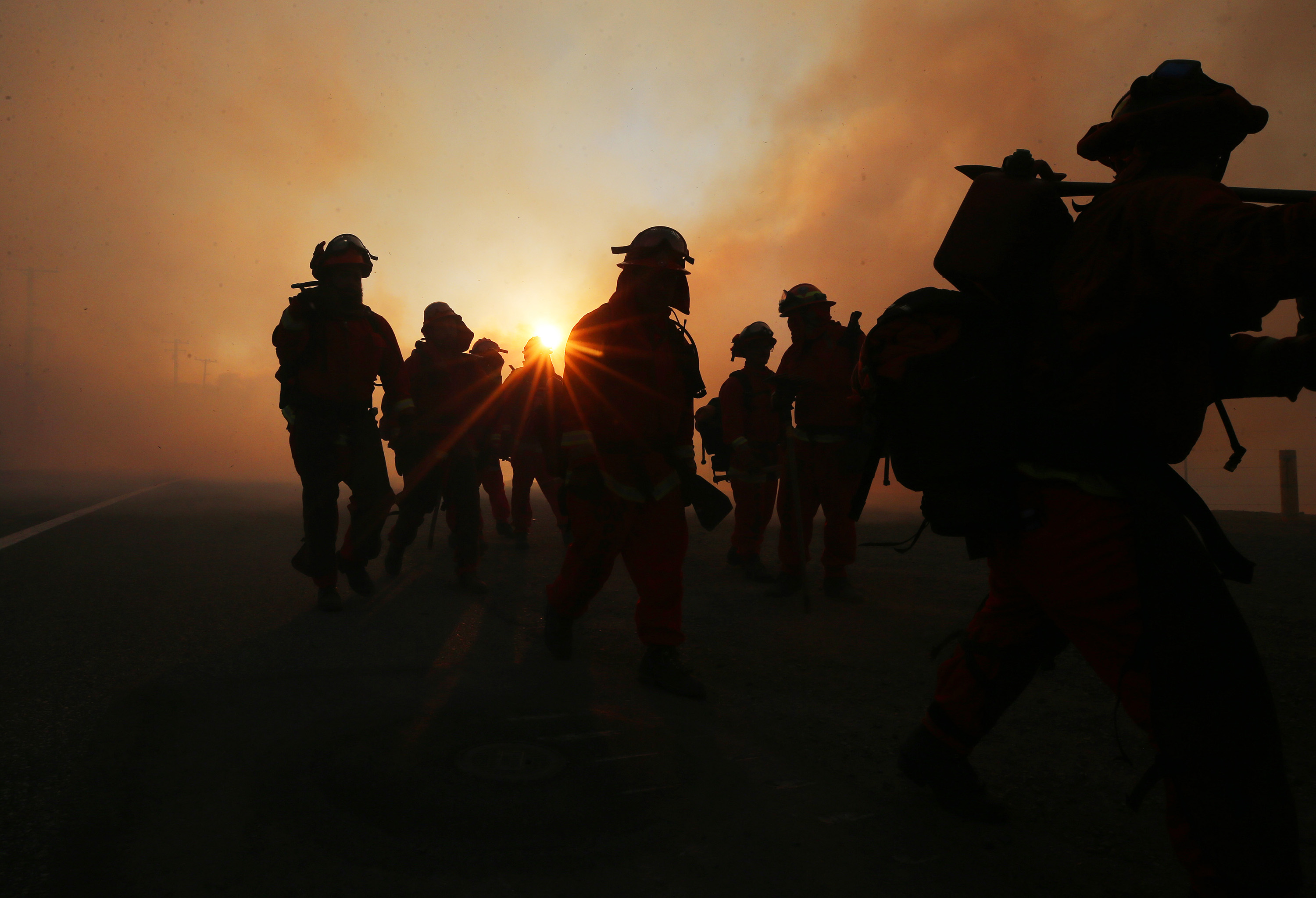 firefighters work as the Bond Fire burns in Silvarado Canyon