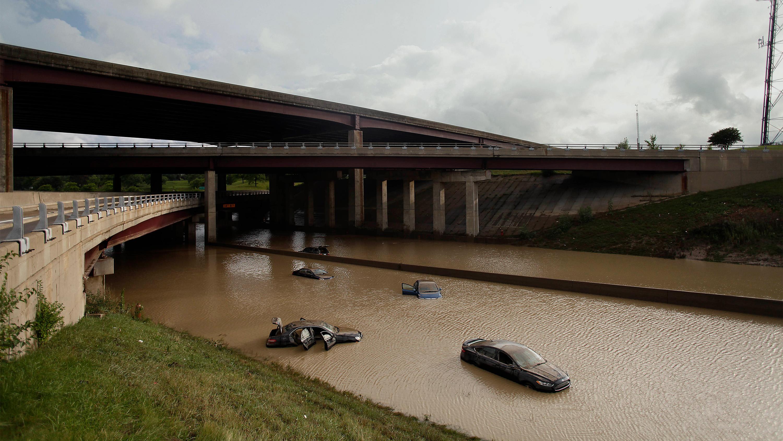 abandoned vehicles on flooded highway near Detroit
