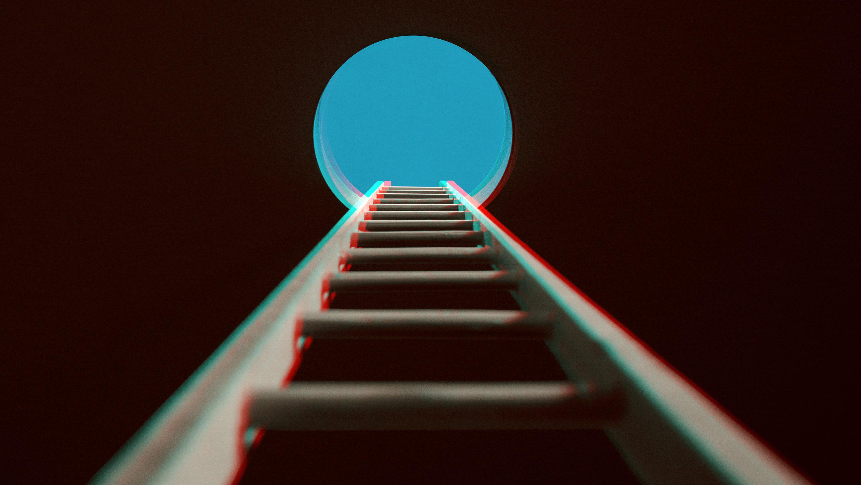 Ladder through aperture to sky