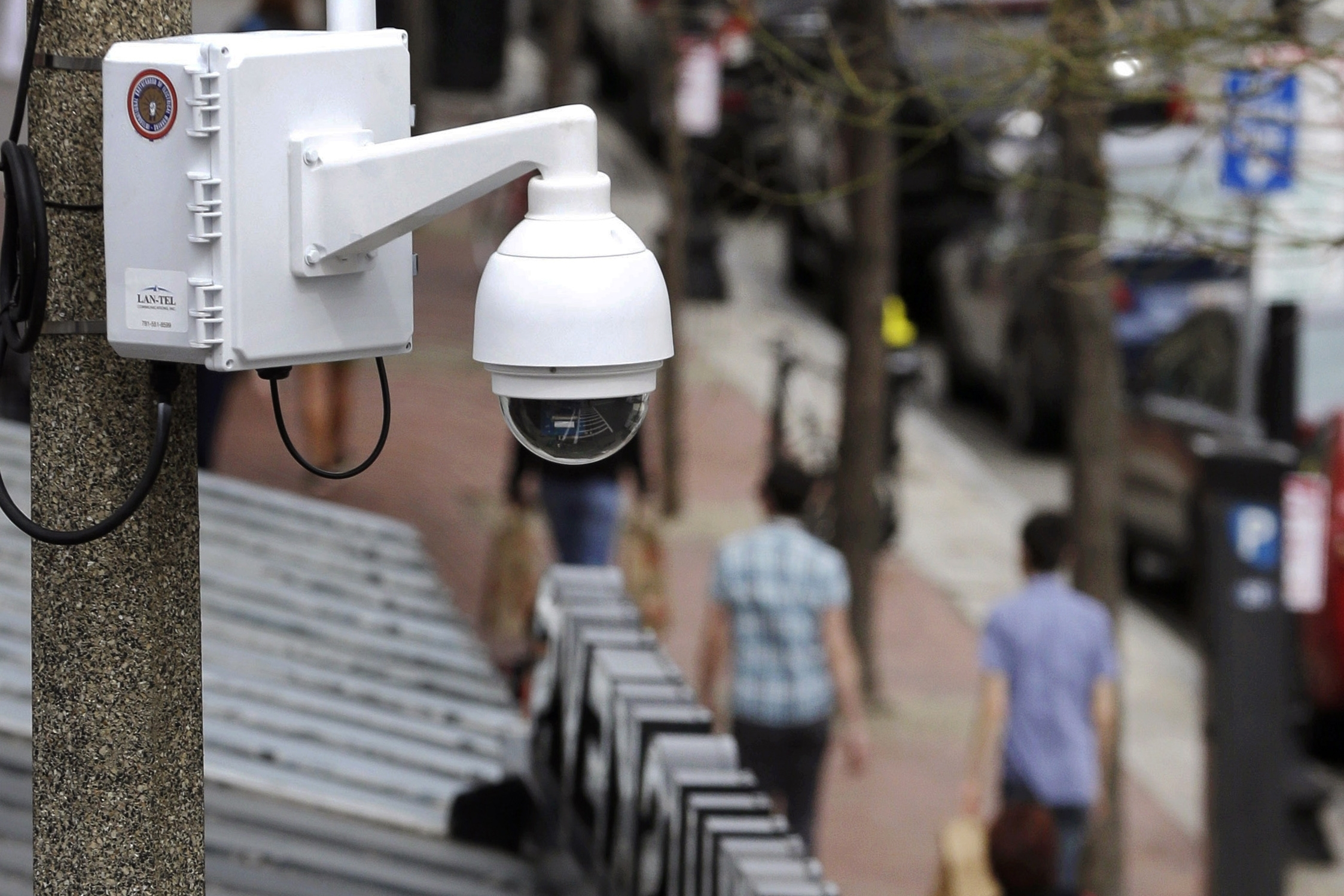 In this April 14, 2014 photo, a surveillance camera is attached to a light pole along Boylston Street in Boston. The Boston City Council voted unanimously, Wednesday, June 24, 2020, to pass a ban on the use of facial recognition technology.