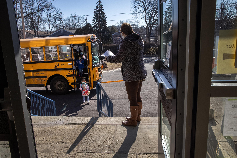 kids return to school on bus
