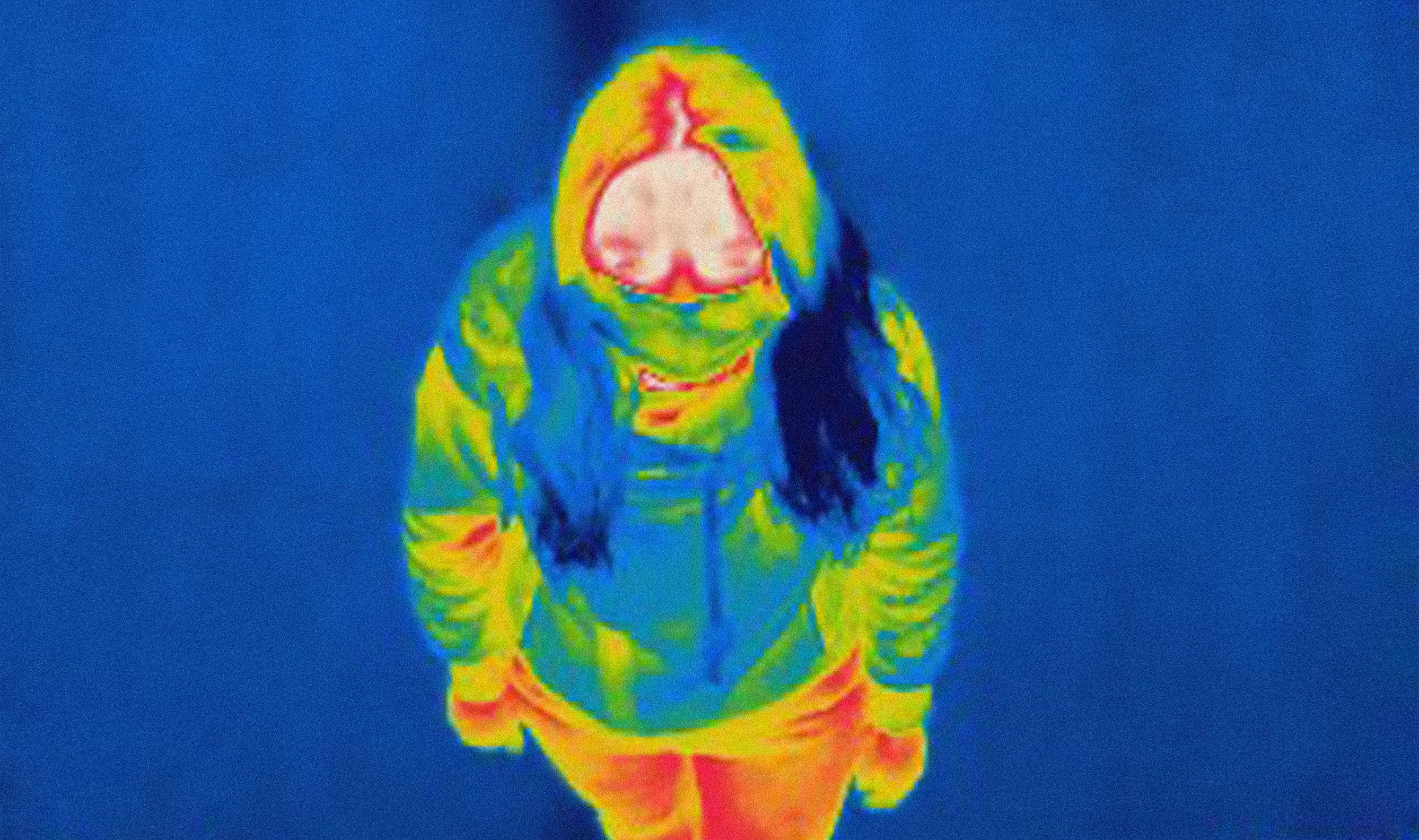 thermal image of young woman wearing mask