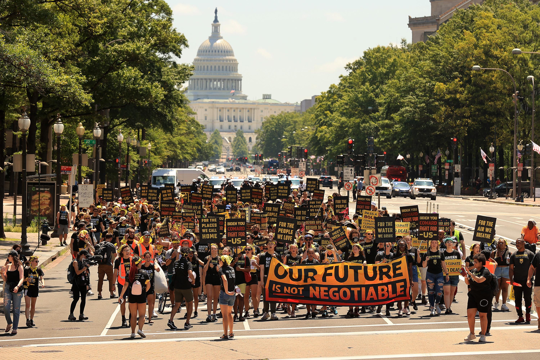 climate activists march on Pennsylvania Avenue